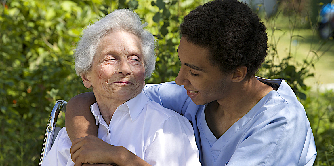 caregiver hugging sernior woman