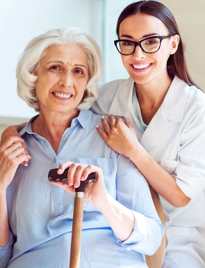 smiling caregiver and senior woman