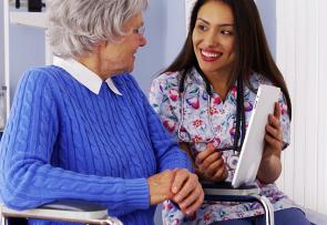 elderly woman talking to her caregiver