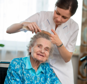 old lady with her caregiver combing her hair