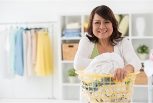 Woman holding basket full of clothes