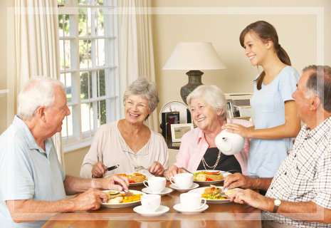family dine together with their caretaker