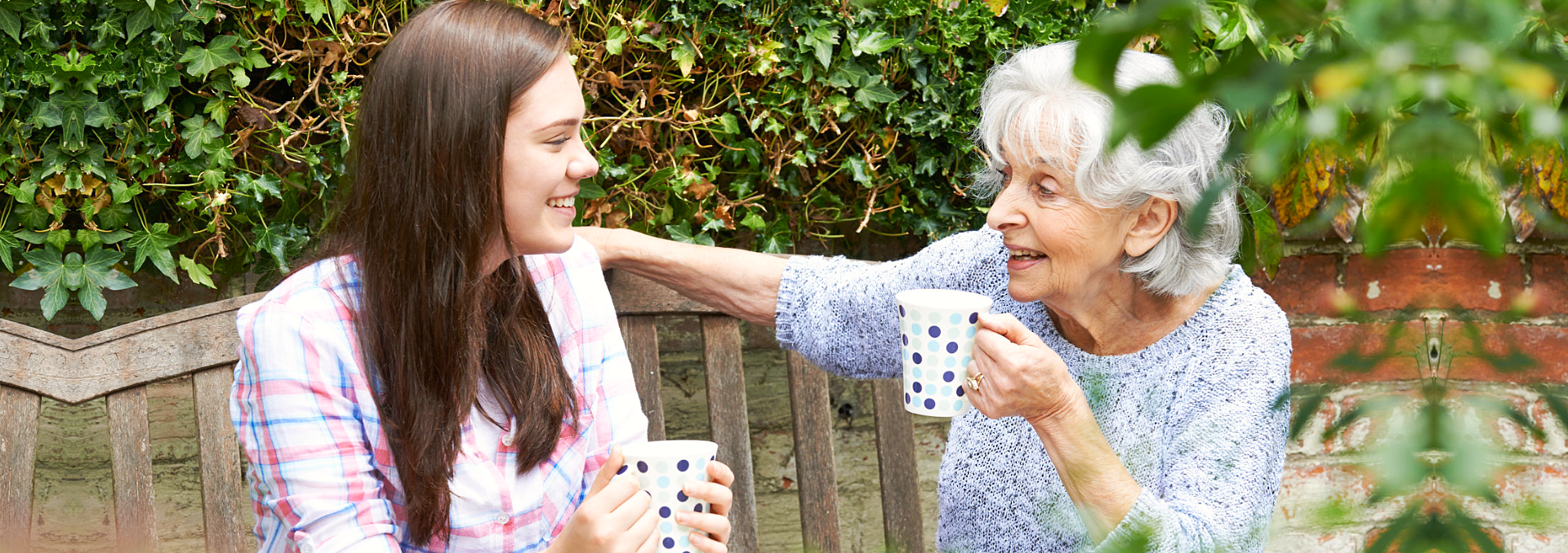 grandma and her caretaker having tea time